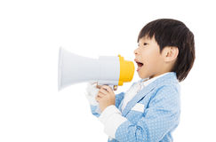 Little boy shouting in megaphone isolated. Happy little boy shouting in megaphone isolated Stock Photography