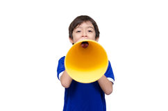 Little boy shouting with the megaphone on white bakcground Royalty Free Stock Images