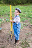 Little boy with shovel on field Stock Photos