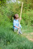 Little boy with shovel looking for treasures. Happy childhood. Adventure hunting for treasures. Little helper working in. Garden. Cute child in nature having stock photography