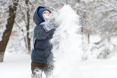 Little boy with shovel playing in snow Royalty Free Stock Photos