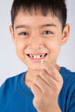 Little boy showing baby teeth toothless close up waiting for new teeth. Little boy showing baby teeth toothless waiting for new teeth Royalty Free Stock Photography