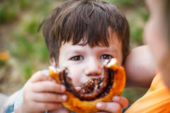 Little boy showing cocoa snail Stock Photos