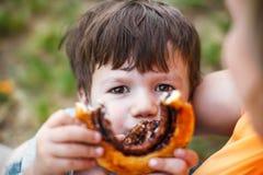 Little boy showing cocoa snail Stock Photos