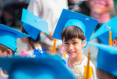 Little boy showing graduated hhat uniform at kindergarten school Royalty Free Stock Photography