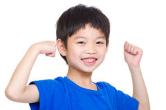 Little boy showing hand biceps muscles Stock Photo