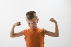 Little boy showing his muscles. White background Royalty Free Stock Photos