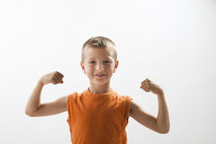 Little boy showing his muscles. White background Stock Images