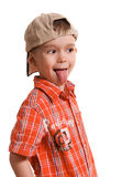 Little boy showing his tongue. And teasing somebody against white background Stock Image