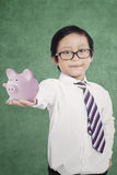 Little boy showing moneybox Stock Photography