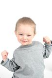 Little boy showing muscles. On white background Stock Photos