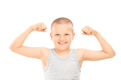 Little boy showing muscles Royalty Free Stock Images