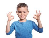 Little boy showing OK gesture in sign language. On white background stock photo