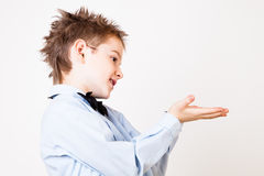 Little boy showing open palm. Royalty Free Stock Photography