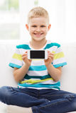 Little boy showing smartphone black blank screen Royalty Free Stock Images