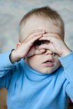 Little boy showing the spying glass/spying/ Stock Photo