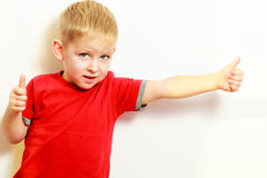 Little boy showing thumb up success hand sign gesture. Stock Image