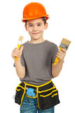 Little boy showing two paint brushes Stock Photography