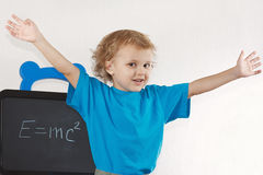 Little boy shows Einstein's formula Royalty Free Stock Photo