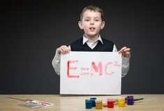 Little boy shows energy formula he painted Royalty Free Stock Photo