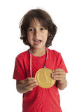 Little boy shows a first place medal Royalty Free Stock Image