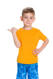 Little boy shows his finger to the side Stock Image