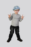 Little boy shows horns (hard rock) gesture royalty free stock image
