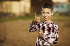 Little boy shows thumbs up Royalty Free Stock Images