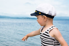Little boy shows up on the sea. Stock Photography