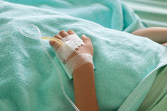 Little boy sick in the Hospital with saline intravenous. Royalty Free Stock Images