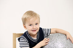 Little boy and the silver ball Royalty Free Stock Photos