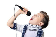 Little boy sing song in microphone. Against white background royalty free stock image
