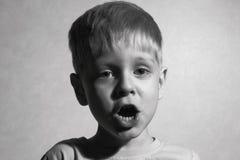 Little boy singing Stock Images