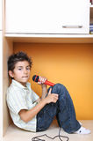 Little boy singing into microphone Stock Images