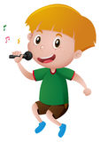 Little boy singing with microphone Stock Photography