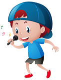 Little boy singing on microphone Stock Image