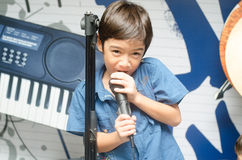 Little boy singing with microphone Royalty Free Stock Photos