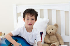Little boy singing and playing guitar Stock Image