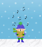 Little Boy Singing in the Snow. Small boy singing from a songbook outdoors in the snow Royalty Free Stock Photos