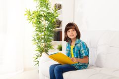 Little boy sit with book and reading stock images