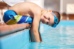 Little boy sit on edge of pool Royalty Free Stock Photography