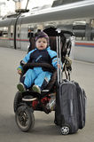 Little boy sit in pushchair with luggage at the railway station. Russia, Saint Petersburg Stock Image
