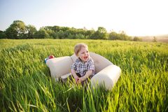 Little boy sits in chair Royalty Free Stock Photo