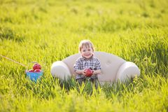 Little boy sits in chair Royalty Free Stock Photography