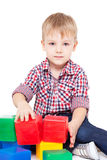 Little boy sits on a floor Stock Photography