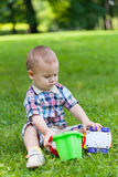 Little boy sits on a grass Royalty Free Stock Photos