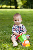 Little boy sits on a grass Stock Image