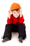 Little boy sits with a helmet Stock Image