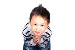 Little boy sits on his lap. Beautiful little boy isolated on white background prays to God sits on his lap in a sweater and jeans Stock Photos