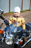 Little boy sits on motorcycle Royalty Free Stock Photos